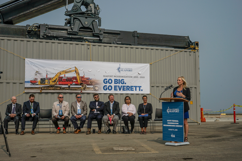 Lisa Lefeber, Port of Everett Acting CEO speaking (a Boeing big box is in the background)