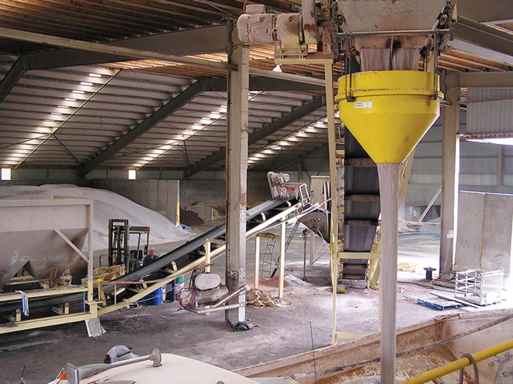 TH White Projects' dust suppression hopper funnels material through a restricted orifice and cone