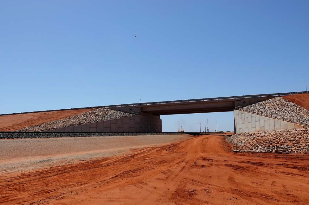 New Roy Hill-funded rail bridge carries the Great Northern Highway over the miner's rail line
