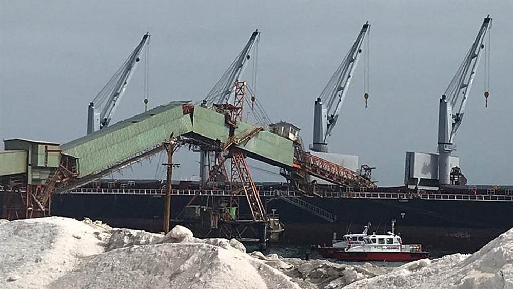 After this photo was taken, the buckled part of the structure collapsed into the sea