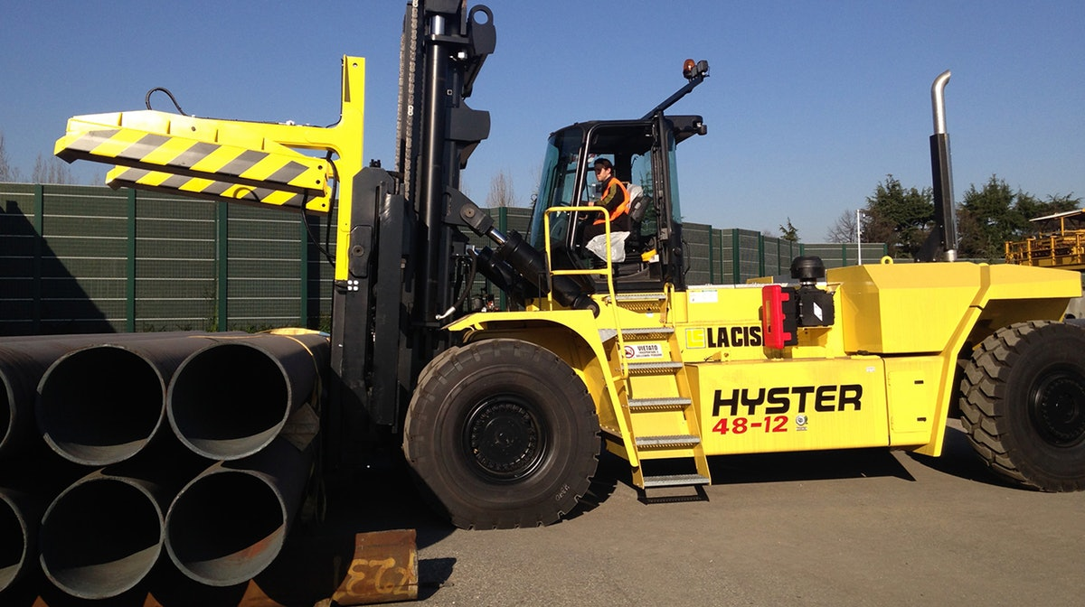 A Hyster 48-12 handling steel pipe in NZ.