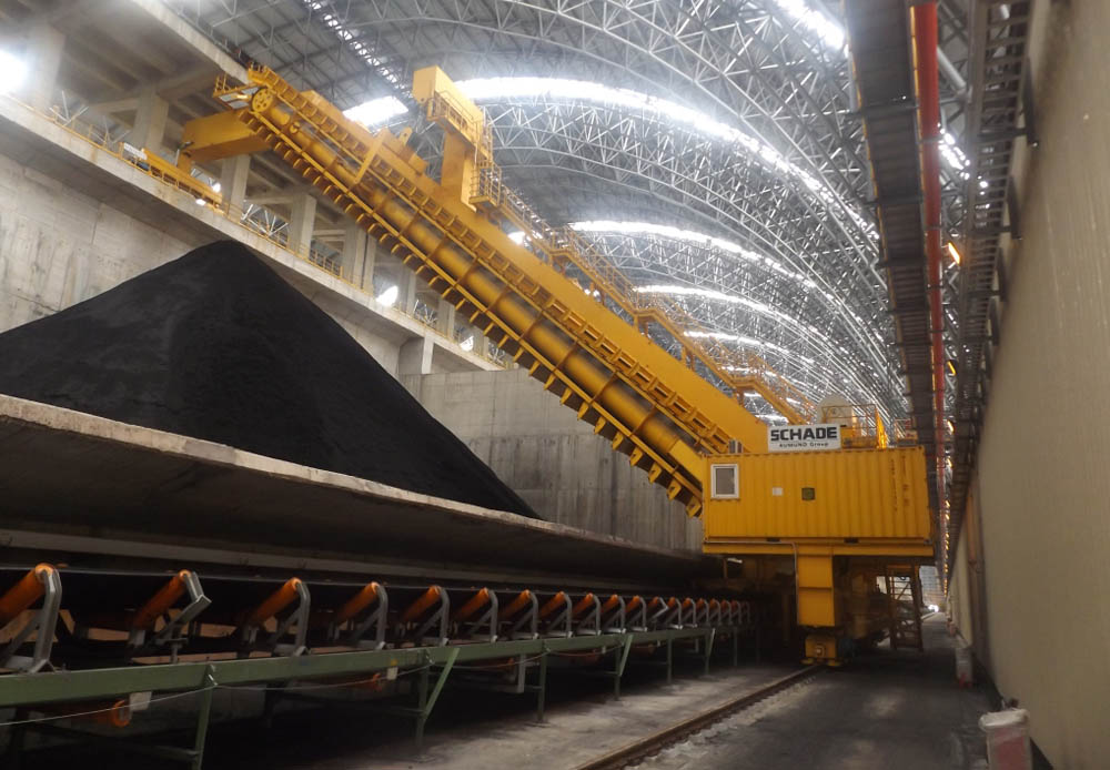 An example of a Schade semi-portal reclaimer in operation at Ha Tinh Steel, Vietnam