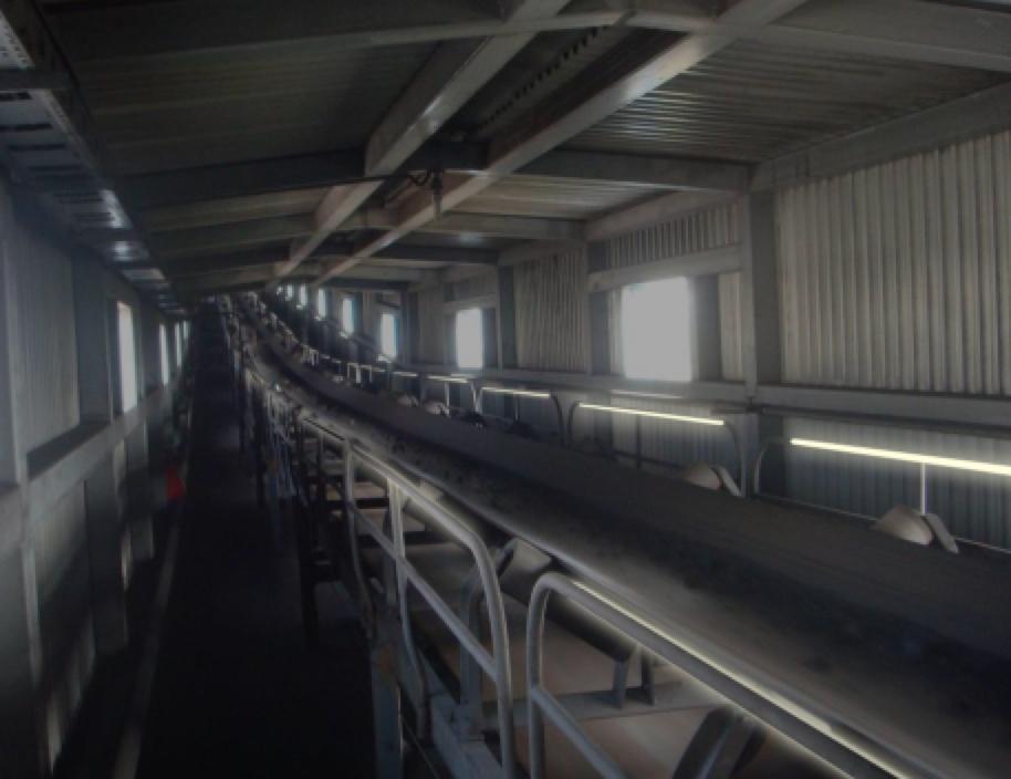 The Smart Self-luminous Handrail in a conveyor application.