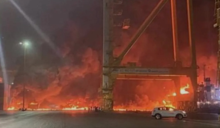 The vessel was berthed away from STS cranes, none of which appear to have been damaged by the blaze (photo: Dubai Media Office Twitter)